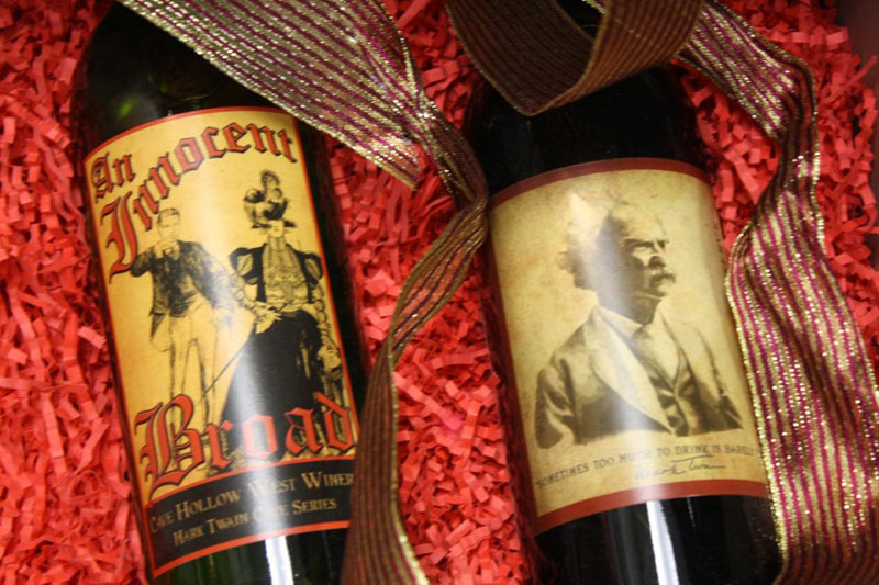 two bottles of wine on a red background