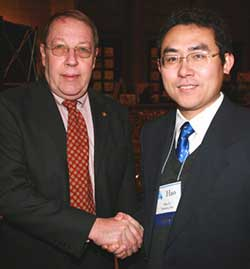 State Rep. Ed Robb shaking hands with Hao Li