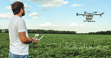 Farmer flying drone