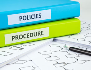 binders labeled policies and procedures