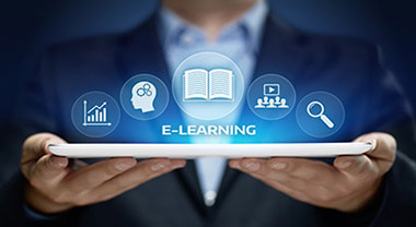 Man holding tablet with eLearning icons hovering above it