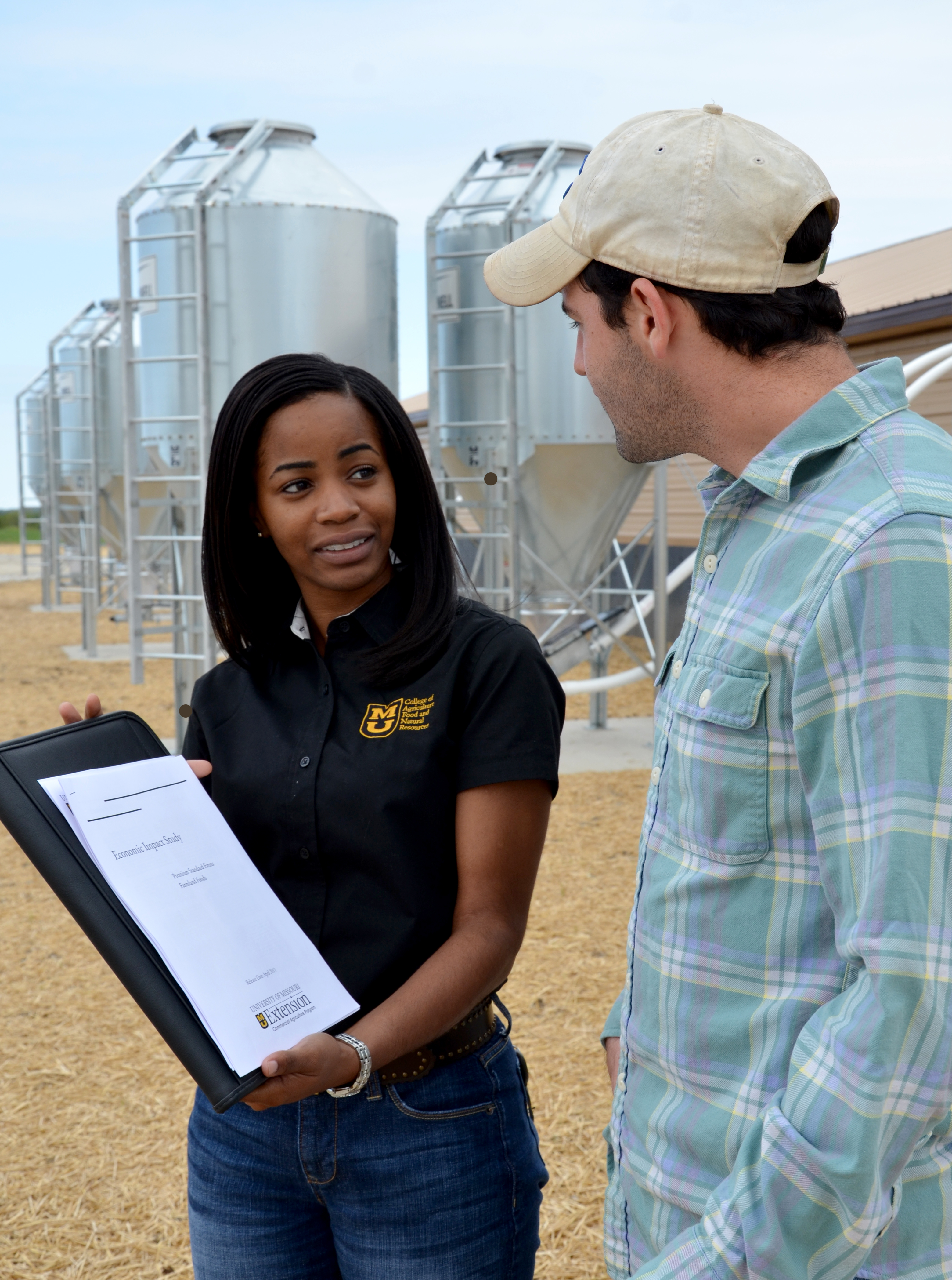 Seanicaa Edwards, left,  swine economist for MU Extension's Commercial Agriculture program, with Joseph Dolginow, MU graduate research assistant in agricultural economics. The Commercial Ag program is one example of the land-grant university's role in adv