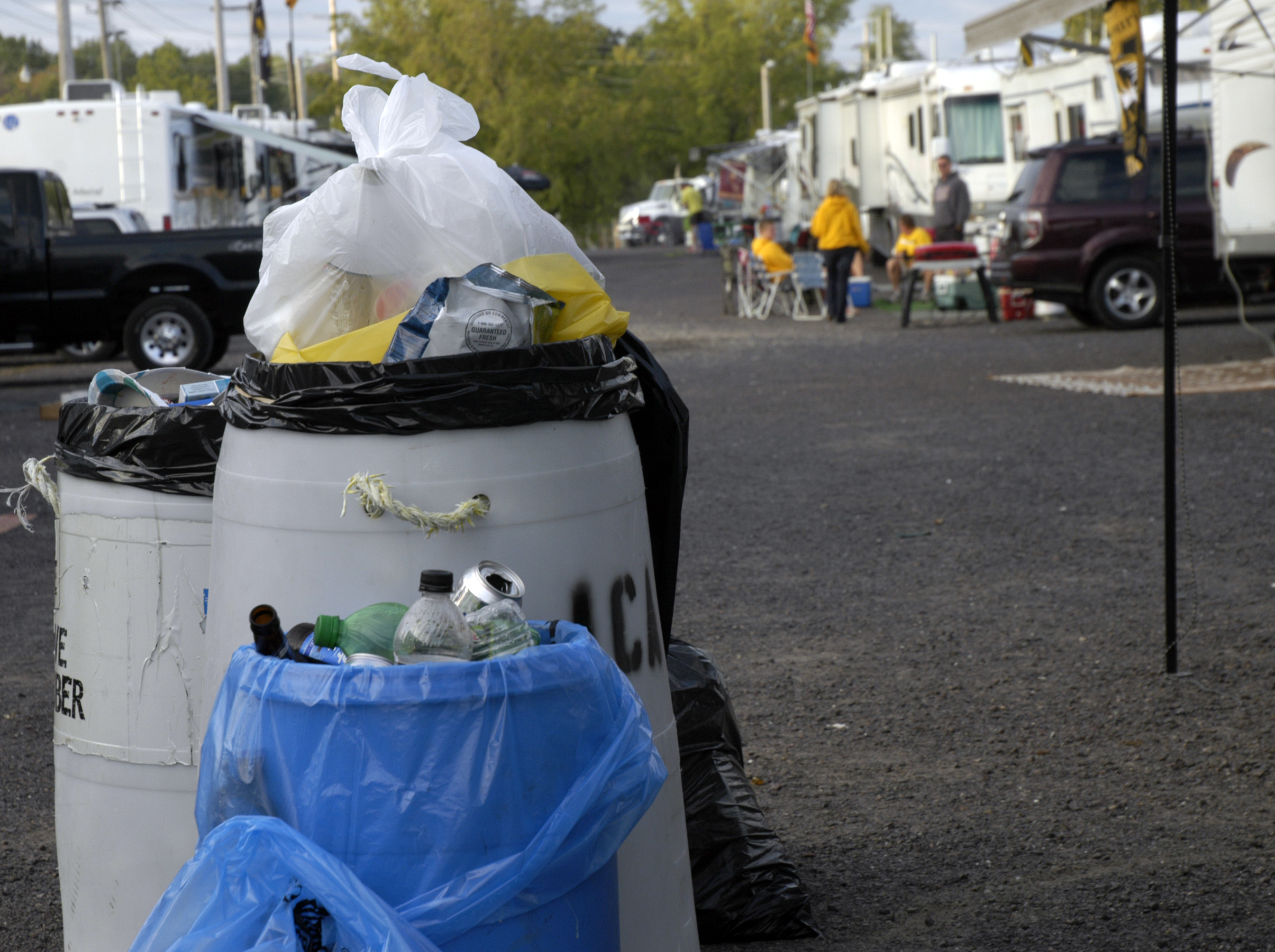 MU hands out blue bags to tailgaters to encourage recycling of metal, glass and plastic refuse.