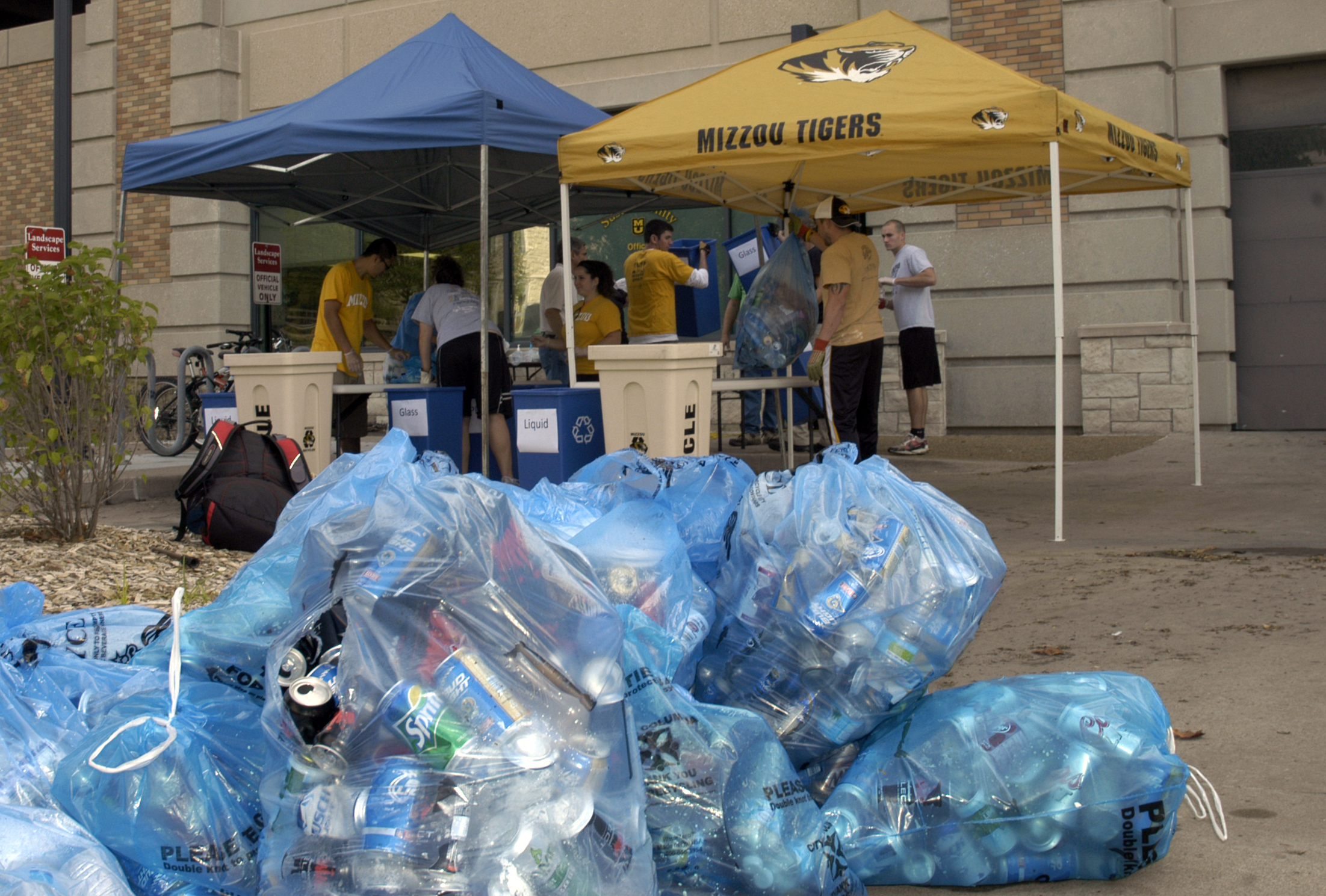 Students weighed and examined game-day trash outside the MU Sustainability Office.