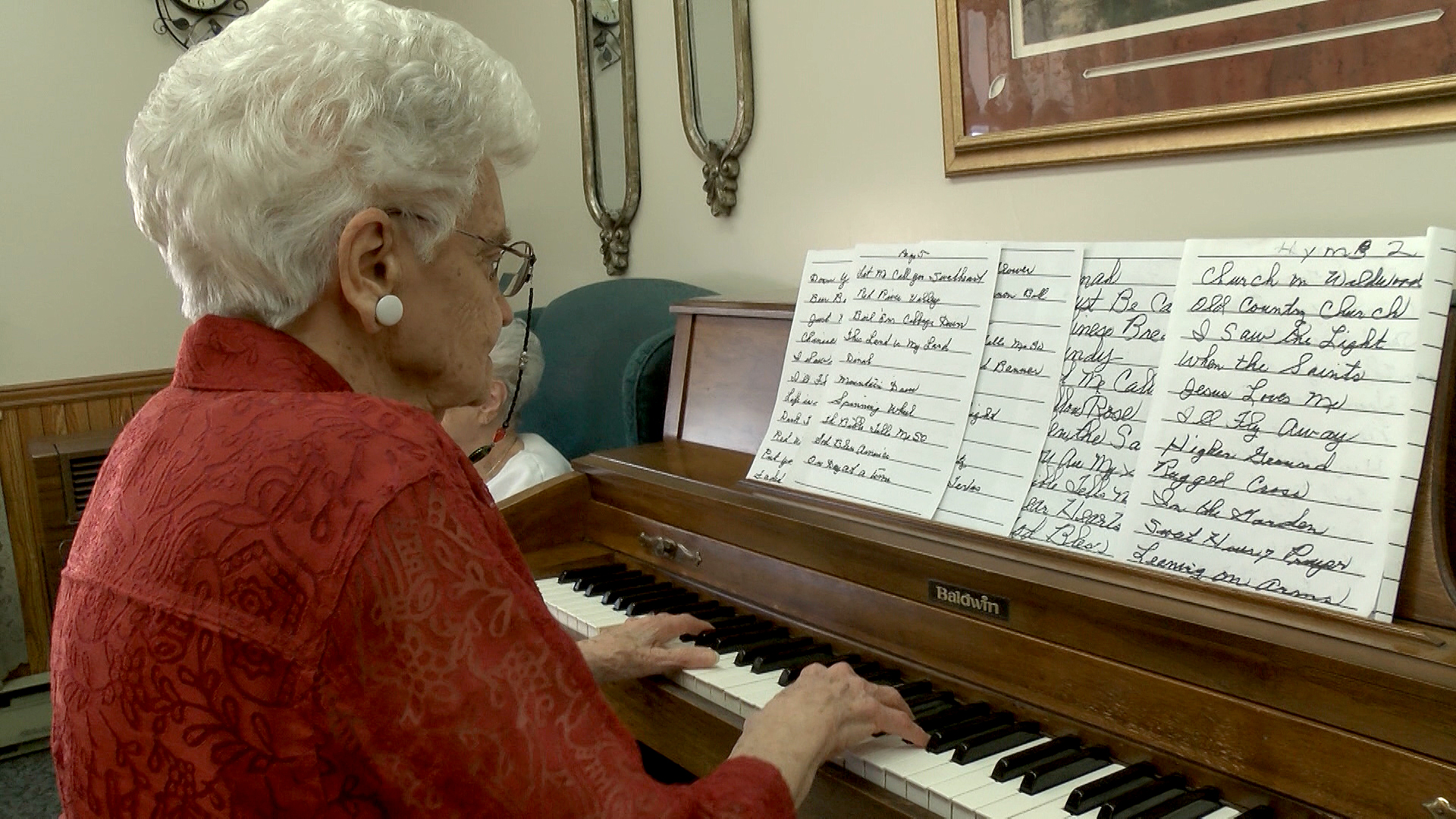 Loch Haven resident Doris White enjoys playing piano in the Loch Haven Washboard Band.