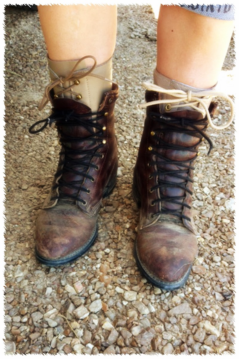 Portell wears sturdy lace-up boots over braces to give her stability while feeding cattle.