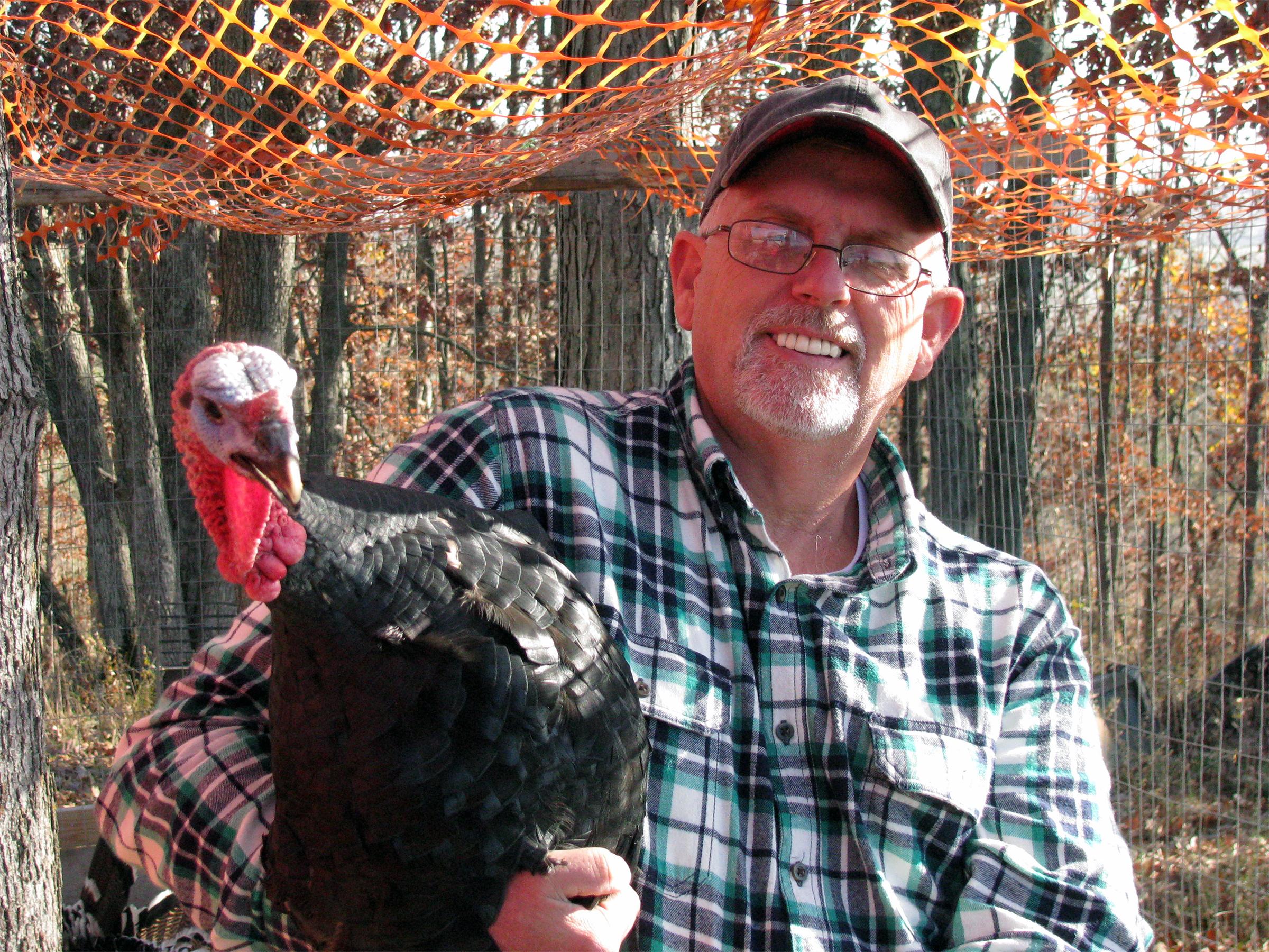 Rod Belzer raises heritage turkeys at Winigan Farms in Sullivan County, Mo.