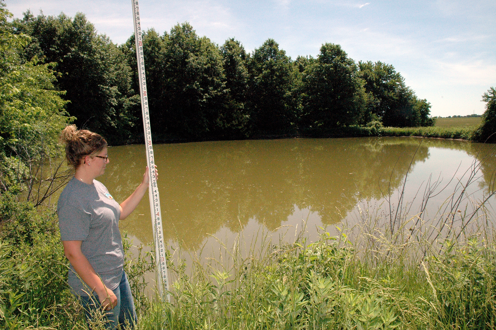 NRCS district technician Cassie Lenzenhuber was part of the team that evaluated Matthew Spiers' pond for gravity-fed tanks.