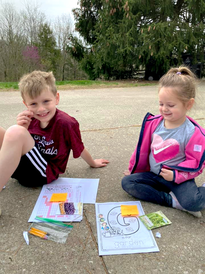 Perry County youths Quintos Kutz, left, and sister Libby received activity and learning packets from MU Extension in Perry County.