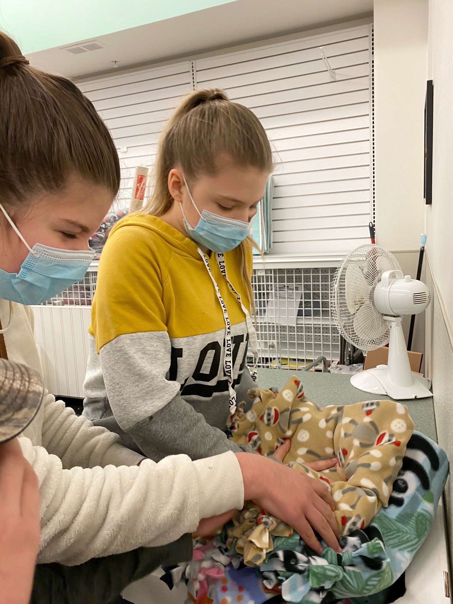 Boone County 4-H'ers Chloe Beal, left, and sister Zoe working on blankets for Project Linus.