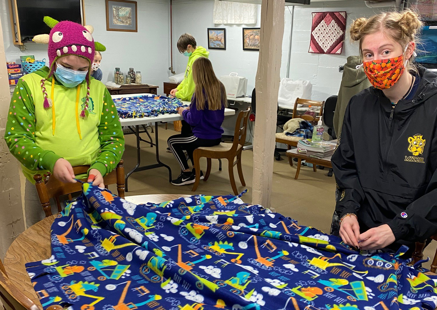 St. Charles County 4-H'ers Audrey Coletti, left, and Anna Bello. Club members and volunteers made 16 blankets for Project Linus.