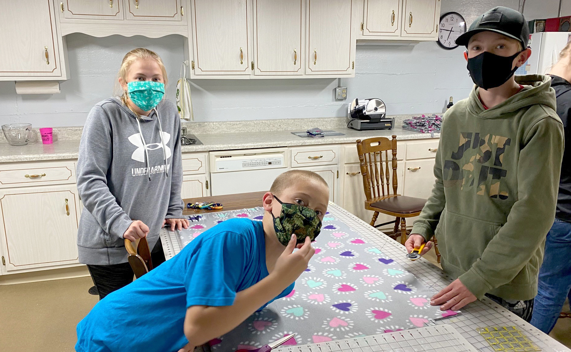 From left, St. Charles County 4-H'ers Sophia Bello, Eric Bello and John Zumbehl making blankets for Project Linus.