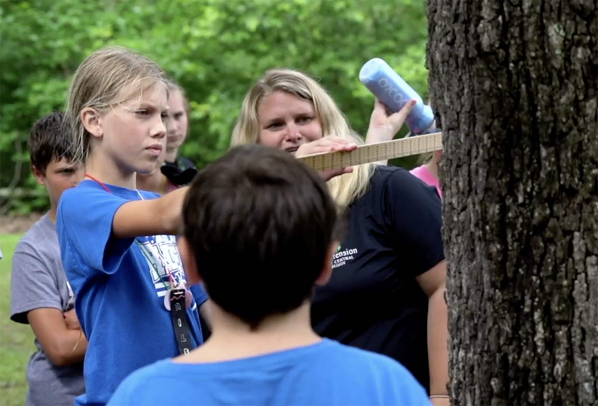MU Extension provides educational opportunities for Missourians of all ages. Natural resources specialist Sarah Havens teaches youths how important trees are to the environment.