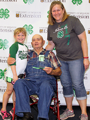 Three generations of 4-H participants pose for a photo.