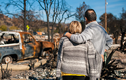 Couple surveying the scene after a disaster