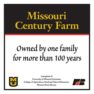 A Missouri Century Farm sign that says, 'owned by one family for more than 100 years,' and lists the program sponsors: University of Missouri Extension; College of Agriculture, Food and Natural Resources; and Missouri Farm Bureau