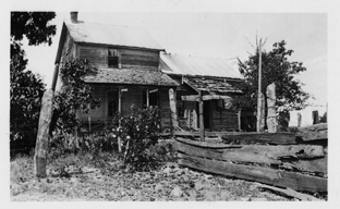 Old photo of farmhouse and fence