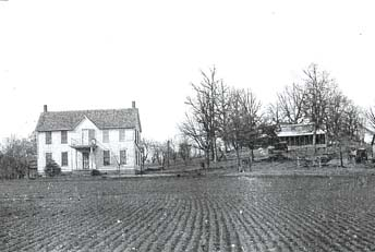 Old photo of farmhouse and field