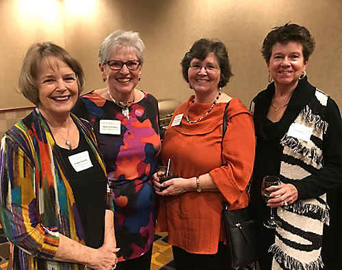 A group of four women posing for a picture at an Osher event.