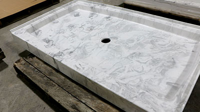 A marble looking shower base manufactured by Prock Operations.