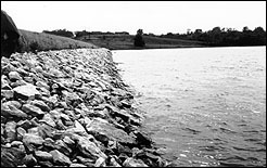 Rock riprap may be required to protect a dam from wave action, especially if the dam faces the prevailing wind or has a large pond.