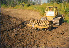 A sheepsfoot roller provides the high degree of compaction often necessary to seal permeable soils at a pond site.