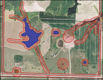 Aerial photograph of a farm with setbacks around sensitive areas shown in red