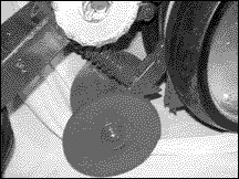 Adjust closing wheels so that the seed furrow is closed by varying spring tension