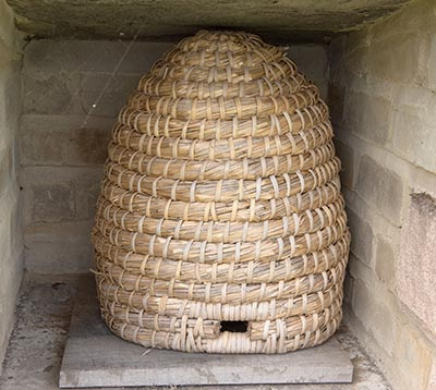 A skep, a basket-woven beehive